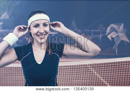 Female athlete wearing headband and wristband against composite image of tennis net
