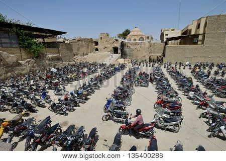 ISFAHAN - APRIL 19: Scooter parking near market (Bazaar) in Isfahan, Iran on April 19, 2015. Bazaar of Isfahan is the most important tourist attraction in Isfahan, Iran.