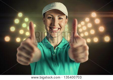 Sportswoman posing on black background against digitally generated image of spotlight