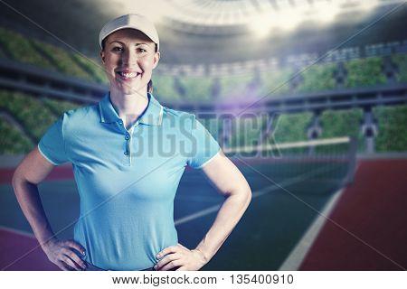 Sportswoman posing on black background against tennis field on the night
