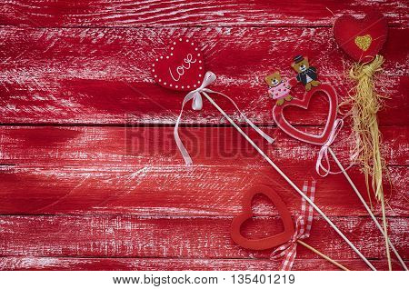 Carved wooden red heart on a vintage wooden red background