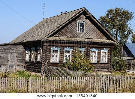 Old wooden house in the village sunny summer day