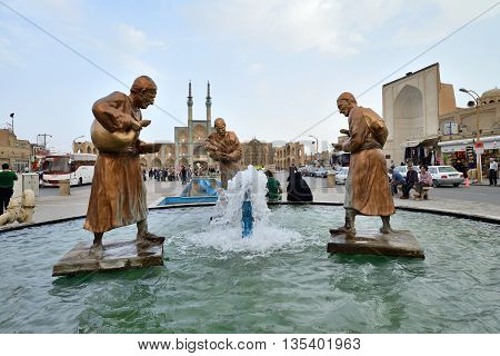 YAZD - APRIL 16: Unknown peoples in street of Yazd, southern Iran on April 16, 2015. Yazd is the capital of Yazd Province, Iran, and a centre of Zoroastrian culture.