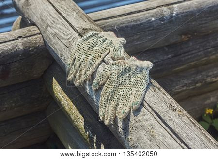 used work gloves on blockhouse close up