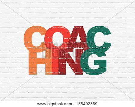 Learning concept: Painted multicolor text Coaching on White Brick wall background