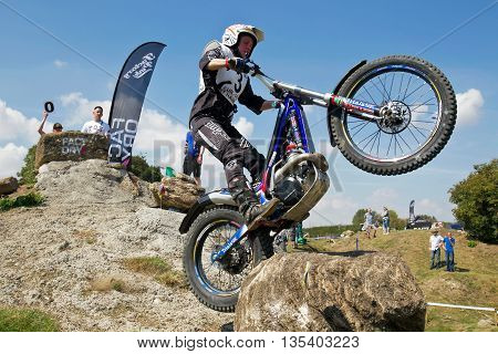 ASTON TIROLD, UK - AUGUST 8: Donna Fox exits one of the rock and hill sections at the NBMCC Supertrial event held at Seymours arena on August 8, 2015 in Aston Tirold