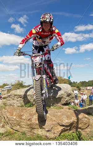 ASTON TIROLD, UK - AUGUST 8: Alexz Wigg reaches the top of a steep slab and ditch section at the NBMCC Supertrial event held at Seymours arena on August 8, 2015 in Aston Tirold