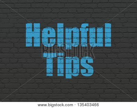 Education concept: Painted blue text Helpful Tips on Black Brick wall background