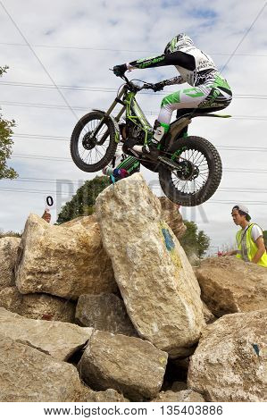 ASTON TIROLD, UK - AUGUST 8: James Dabill successfully jumps over multiple rock boulders without incurring penalties at the NBMCC Supertrial event at Seymours arena on August 8, 2015 in Aston Tirold