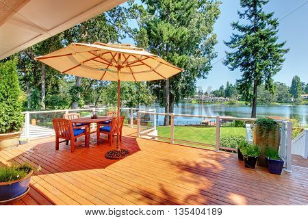 Sitting Room Area On Screened Walkout Deck With Patio Table, Umbrella And Chairs.