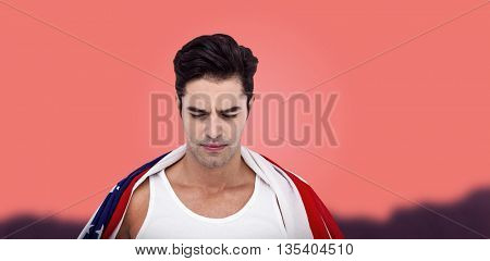 Athlete with american flag wrapped around his body against orange