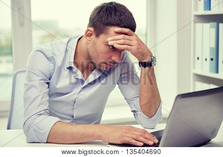business, people, deadline and technology concept - stressed businessman with laptop computer at office