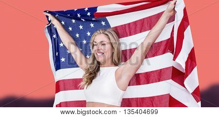 Athlete posing with american flag after victory against orange