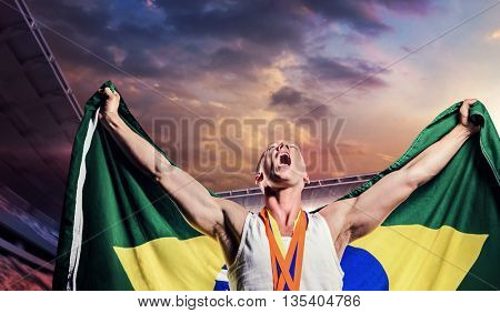 Athlete posing with gold medals after victory against composite image of stadium with cloudy sky