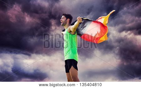 Man wearing German flag against gloomy sky