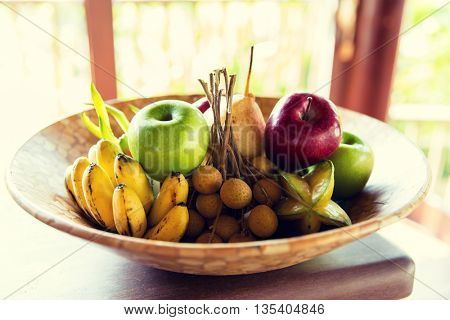 food, eco, bio and summer holidays concept - still life with exotic tropical fruits