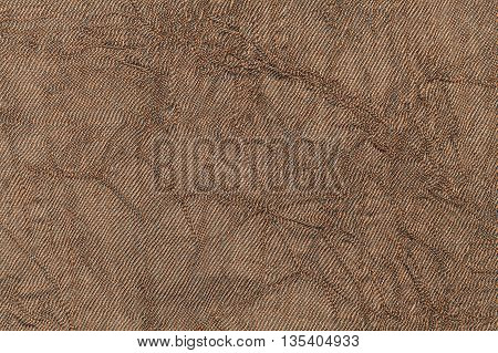 Light brown pearl wavy background from a textile material. Fabric with natural texture closeup. Upholstery fabric pleated.