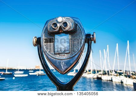 Coin-operated tourist binoculars in USA in front sea and ocean Skyline