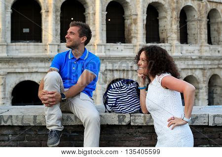 Young couple on the background of the Colosseum, Rome