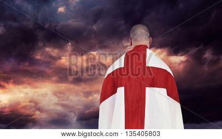 Athlete with england national flag against gloomy sky