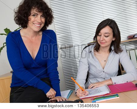 Women In Office Working Together On Desktop