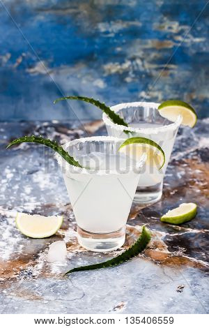 Aloe vera margarita cocktail with salty rim on marble table