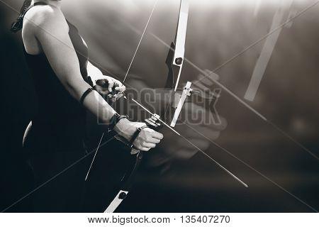 Sportswoman practicing archery