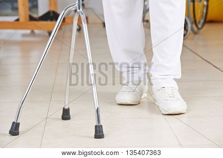 Legs of a man with crutches as support in physiotherapy