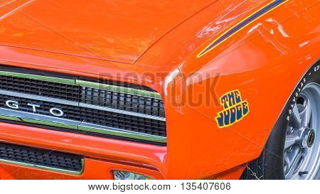 GROSSE POINTE SHORES MI/USA - JUNE 19 2016: A 1969 Pontiac GTO Judge car at the EyesOn Design car show, held at the Edsel and Eleanor Ford House, near Detroit, Michigan.