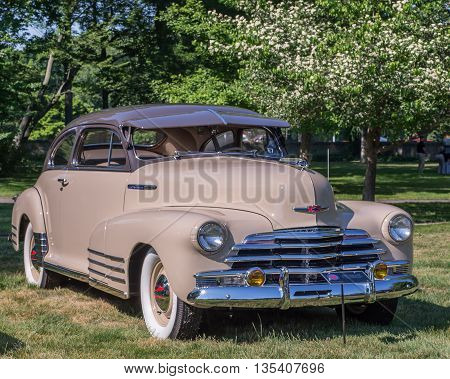 GROSSE POINTE SHORES MI/USA - JUNE 19 2016: A 1947 Chevrolet Fleetline car at the EyesOn Design car show, held at the Edsel and Eleanor Ford House, near Detroit, Michigan.