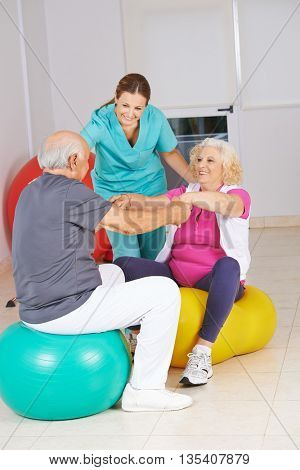 Physiotherapist with senior people at physiotherapy in a nursing home