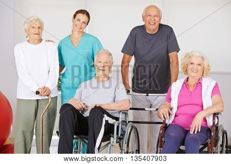 Group of senior people together in nursing home during physiotherapy