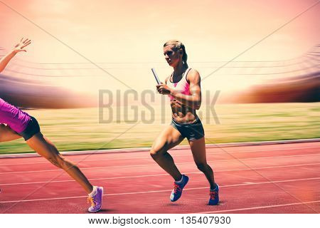 Athletic woman preparing to run against digital image of an athletic track