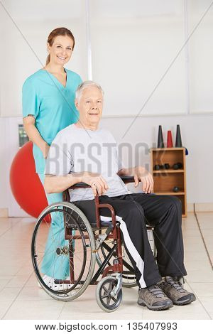 Old man in wheelchair with geriatic nurse in a nursing home