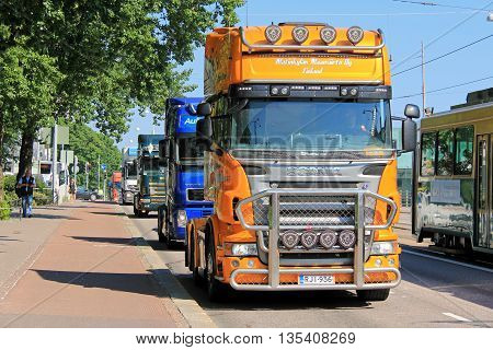 HELSINKI, FINLAND - JUNE 21, 2016: Group of Finnish truck drivers in convoy protest against the new EC Cabotage rules by the Finnish Parliament House in Helsinki.