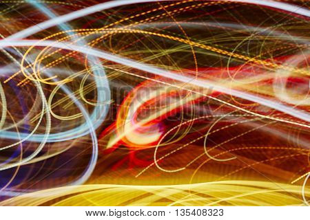 Colorful light trails background at night in a city