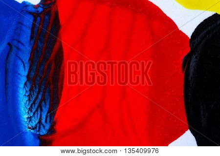 Closeup view of abstract hand painted blue and red acrylic art background on paper texture