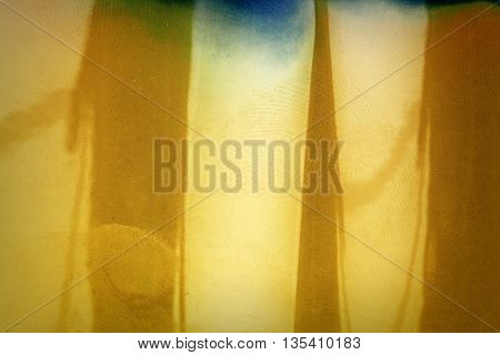 Blank yellow vibrant noisy film strip texture background with fingerprints