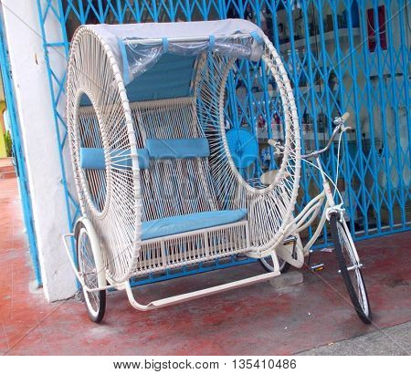 White wicker rental bicycle side car, Georgetown, Penang, Malaysia