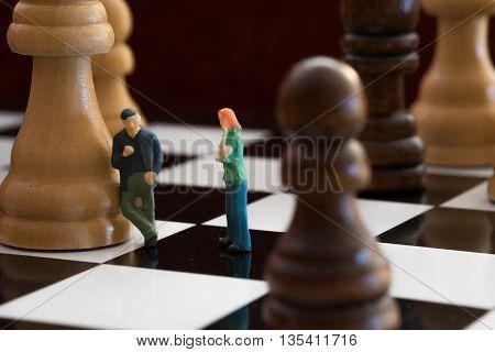 Little People On a Chess Board Talking