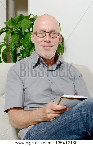 a middle aged man in the sofa