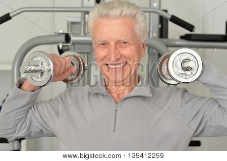 Elderly man in a gym during exercise