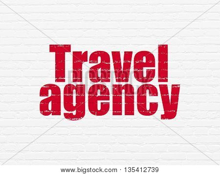Tourism concept: Painted red text Travel Agency on White Brick wall background