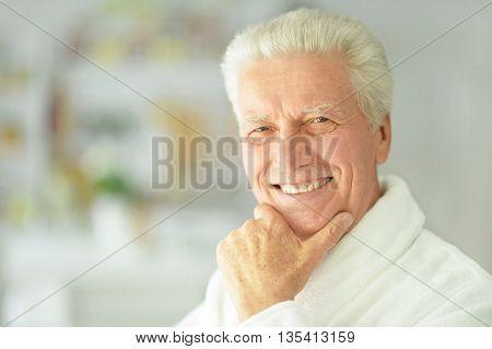 happy Senior man  at home in a bathrobe