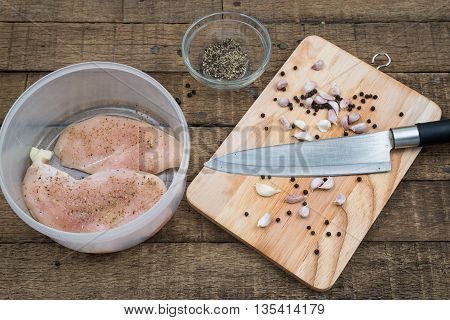 Food series : Marinated chicken breast in plastic container with ingredient nearby