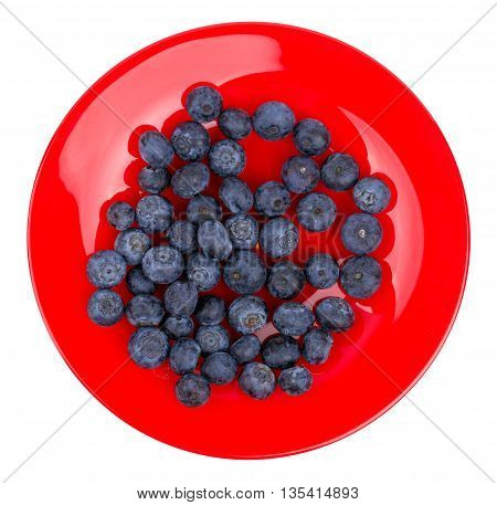 Fresh blueberry on a red plate isolated on a white background