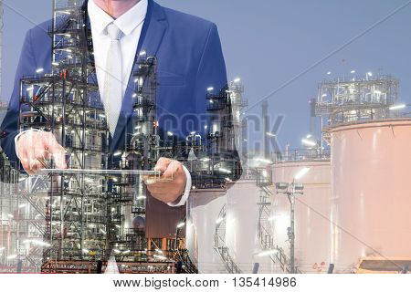 Double Exposure Of Businessman Hand Hold Tablet