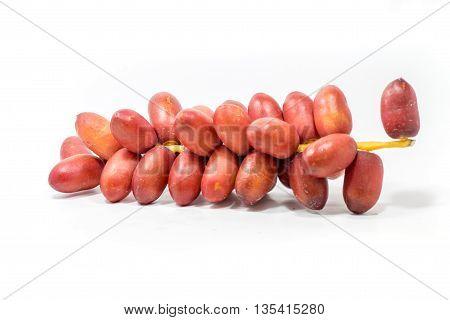 Fresh Red Dates Palm Fruit on White background.