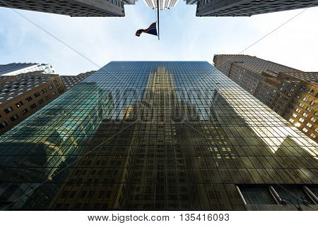 NEW YORK CITY - MARCH 28: Chrysler Building reflection in windows of another building on March 28 2014 in New York, USA