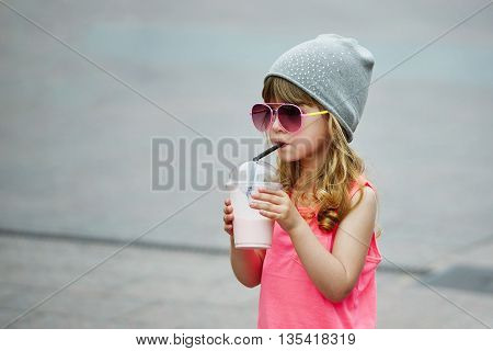 photo of cute little girl with milk coctail